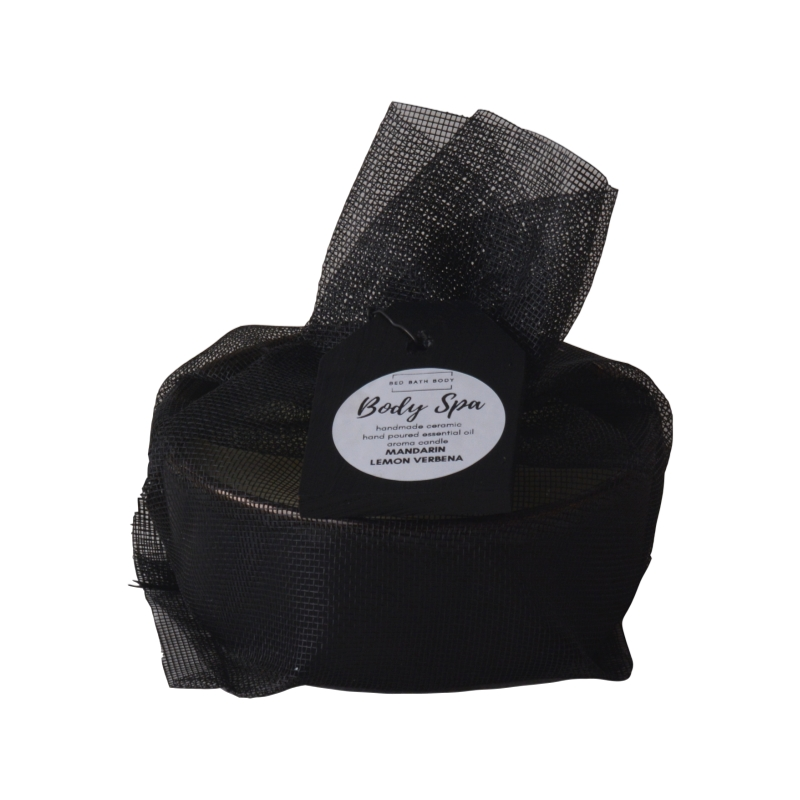 Body Spa matte black and gold handmade ceramic candle in mesh bag